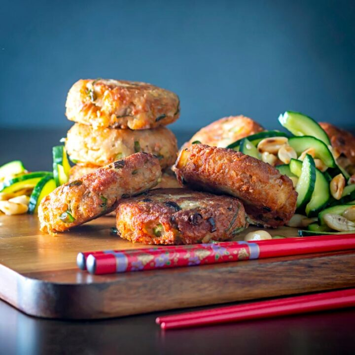 Square image of spicy Thai tuna fish cakes served with a cucumber and peanut salad