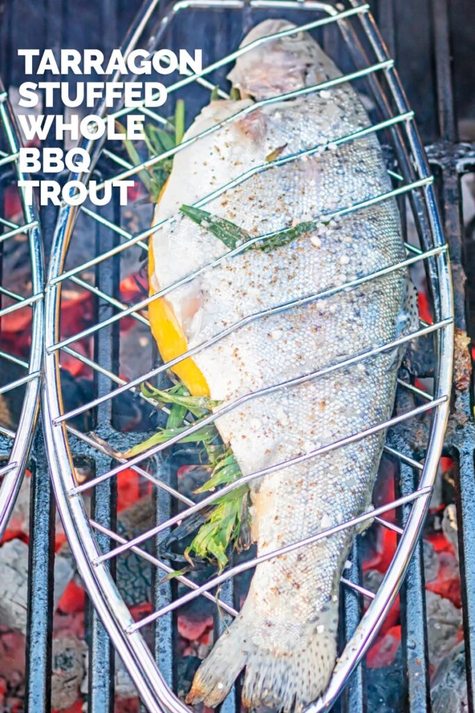 Portrait image of a whole trout being cooked on a BBQ in a fish basket with text overlay