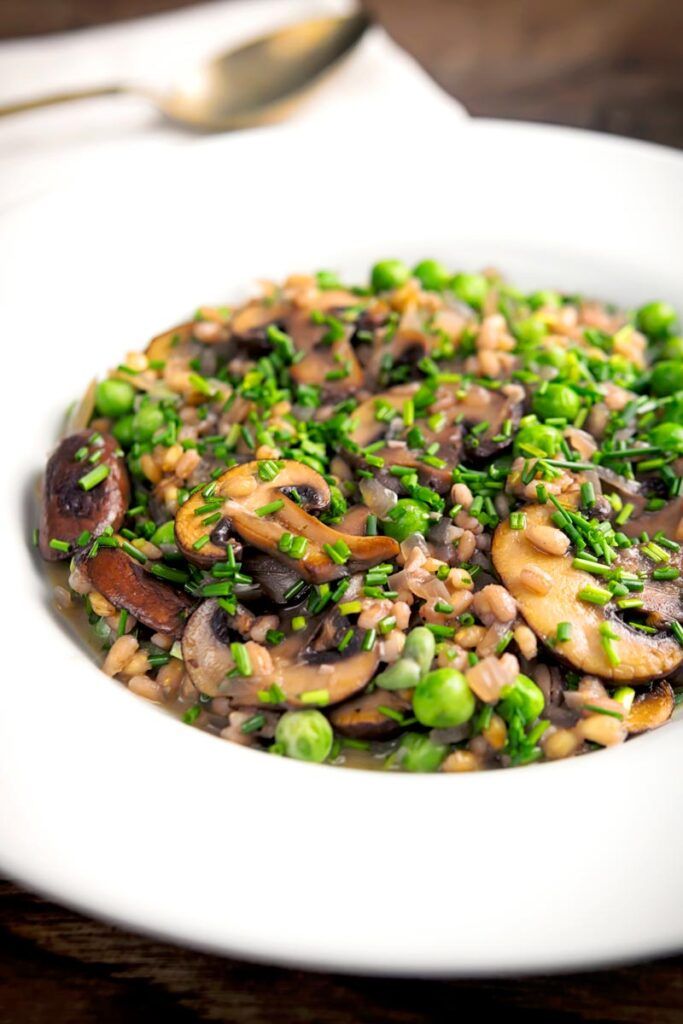 Portrait image of a Pea and Mushroom risotto made with pearl barley
