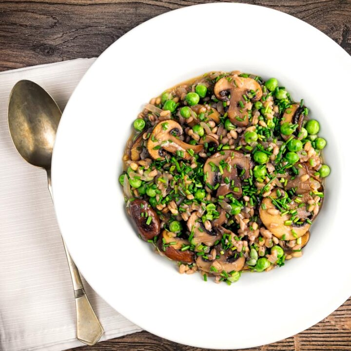 Square overhead image of a Pea and Mushroom orzotto made with pearl barley