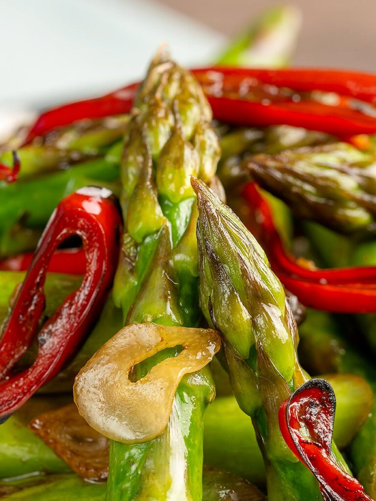 Portrait close up image of asparagus stir fry with chilli and garlic
