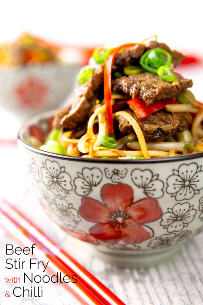 Portrait image of a beef stir fry with noodles, chilli and spring onions served in a bowl decorated in an Asian style with text overlay