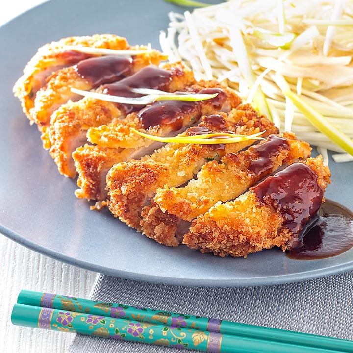 Square image of pork tonkatsu with homemade katsu sauce served with Japanese shredded cabbage