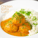 Portrait image of a chicken kofta or meatball curry in a masala sauce with snipped chives with text overlay