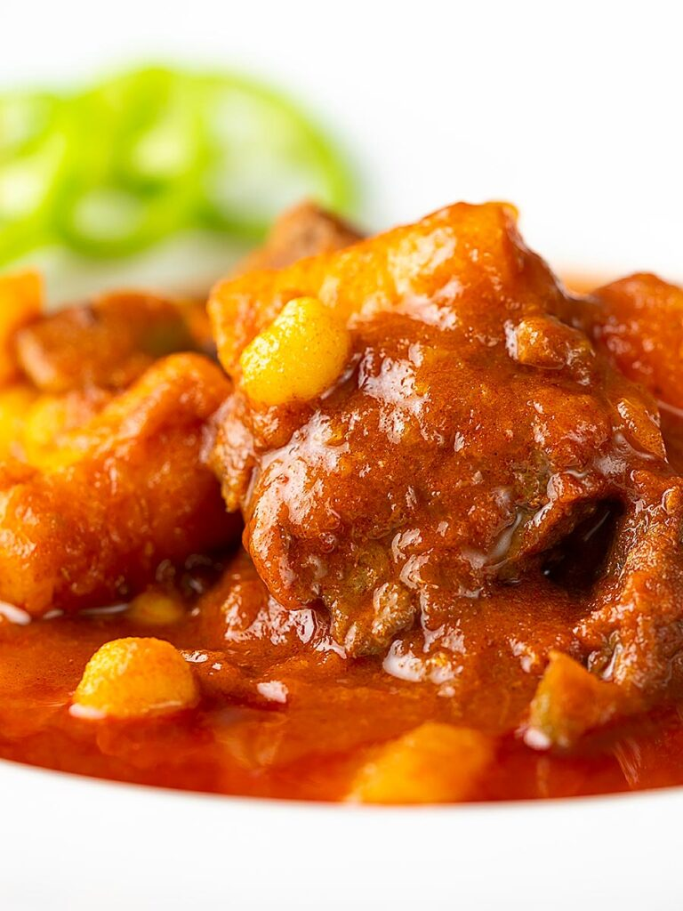 Portrait close up image of a Traditional Hungarian beef goulash or gulyasleves with handmade csipetke (pasta)
