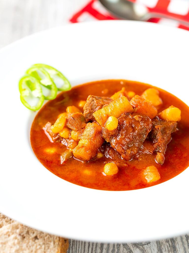 Portrait image of a Traditional Hungarian beef goulash or gulyasleves with handmade csipetke (pasta)