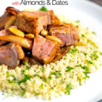 Portrait image of a duck breast tagine with dates and almonds served on a bed of buttered couscous with text overlay