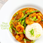 Portrait overhead image of a Thai red prawn curry with green beans served in a white bowl with green onions and jasmine rice with text overlay