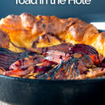 Portrait close up image of a roasted vegetable toad in the hole cooked and served in a cast iron pan with text overlay