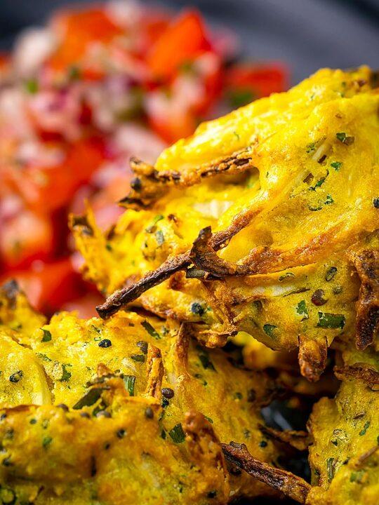 Portrait close up image of crispy air fryer onion bhaji or pakora