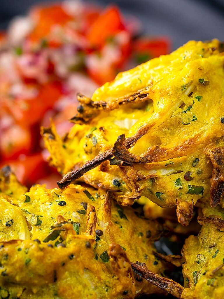 Portrait close up image of crispy air fryer onion bhaji or pakora
