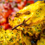 Portrait close up image of crispy air fryer onion bhaji or pakora with text overlay