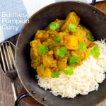 Portrait overhead image of a Burmese influenced vegan pumpkin curry served with white rice and fresh coriander with a text overlay