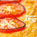 Portrait close up image of cheese and potato pie bake topped with tomato slices featuring a text overlay