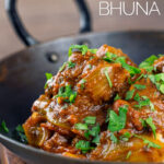 Portrait close up image of a beef bhuna curry served in an iron kadai garnished with chopped coriander featuring a title overlay