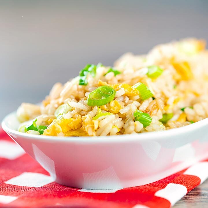 Square image of quick egg fried rice served in a white bowl