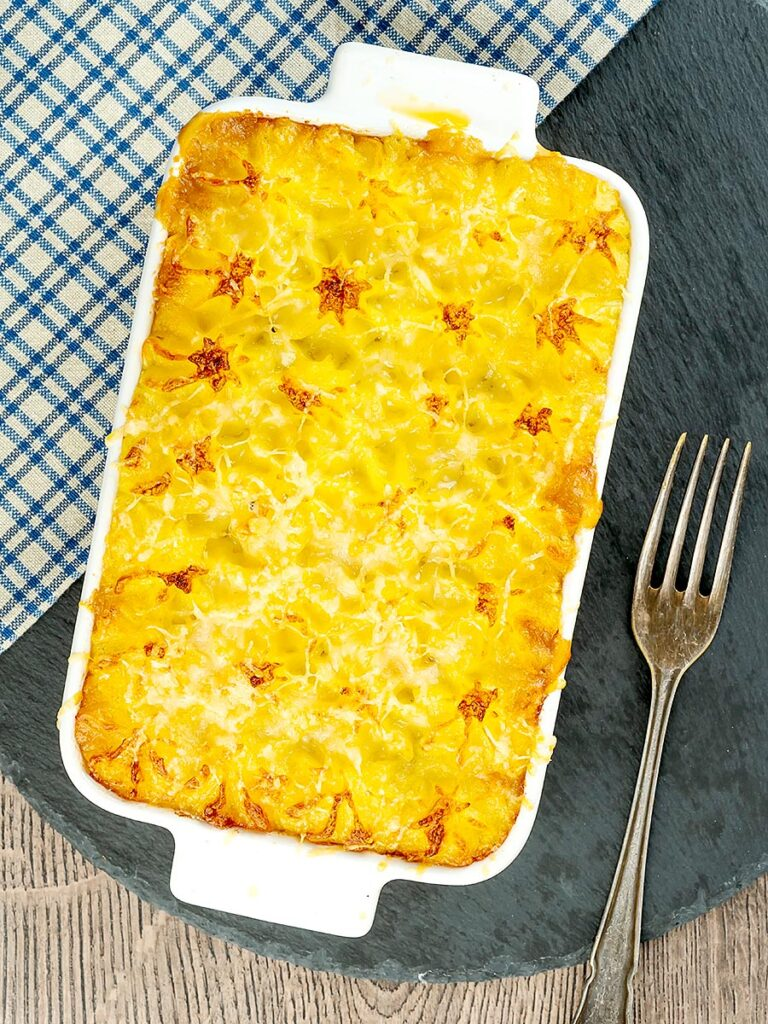 Portrait overhead image of a vegetarian shepherds pie or shepherdess pie served in a white gratin dish
