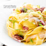 Portrait image of fennel pasta made with pappardelle served with pecan nuts and red onion served in a white pasta bowl featuring a title overlay