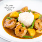Portrait image of a Thai Prawn Massaman Curry with potatoes and green beans served in a white bowl featuring a text overlay