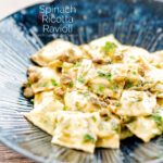 Portrait image of homemade spinach and ricotta ravioli with a lemon caper butter sauce featuring a title overlay