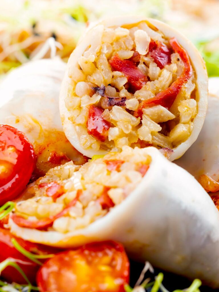 Portrait close up image of brown rice stuffed squid on a tomato sauce