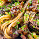 Portrait close up image of a venison ragu served with linguini pasta garnished with snipped chives featuring a text overlay