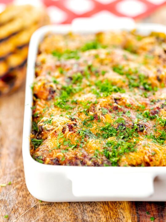 Portrait close up image of gnocchi alla Sorrentina served in a gratin dish with griddled bread