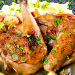 Close up pheasant casserole with a cider gravy, bacon & apples served with mashed potatoes featuring a title overlay.