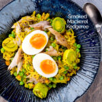 Portrait overhead image of an Indian inspired smoked mackerel kedgeree with boiled eggs and leeks featuring a title overlay