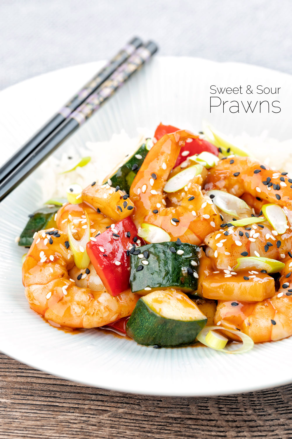 Sweet and sour prawns stir fry with peppers, pineapple & courgette featuring a title overlay.