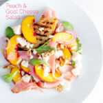 Overhead image of a pickled peach and goat cheese salad with Parma ham and chopped walnuts featuring a title overlay.
