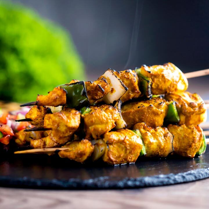 Steaming hot chicken tikka kebab with onion and green pepper