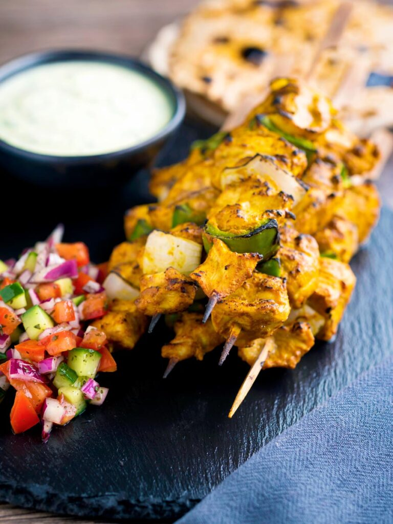 Chicken tikka kebab with onion and green pepper served with kachumber salad & raita