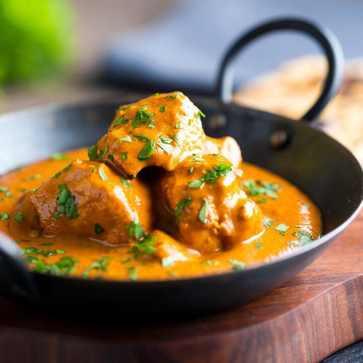 Creamy chicken tikka masala in an iron karai