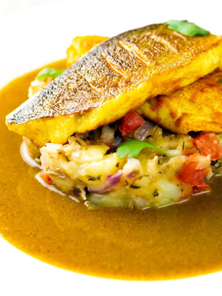 Elegant sea bass fillet curry served with fenugreek potatoes