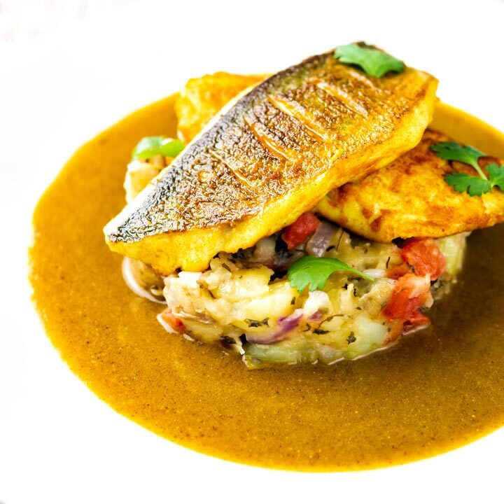 Sea bass curry featuring turmeric fish fillets and tamarind curry sauce & Fenugreek potatoes