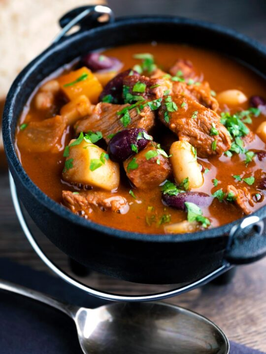 Hungarian bean goulash or babgulyas served in an iron bowl.