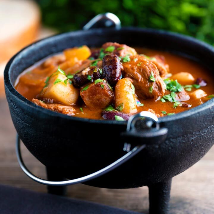 Babgulyas, a Hungarian bean goulash served in a cast iron bowl.