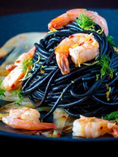 Prawn pasta with squid ink spaghetti fennel, lemon zest and chilli.