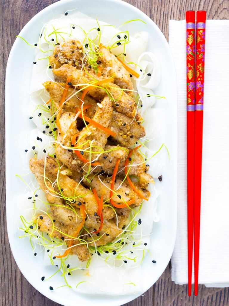 Overhead crispy Chinese salt and pepper chicken with pickled daikon.