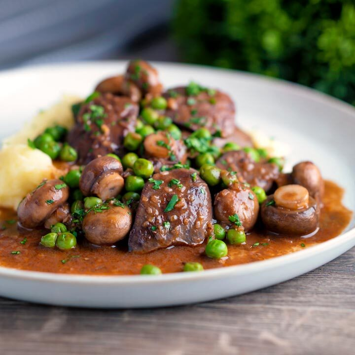 Simple Chicken liver stew with button mushrooms and peas in red wine sauce & mashed potato.