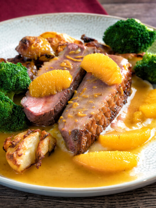 Pan fried duck breast with orange sauce served with roast potatoes & broccoli.