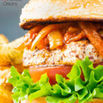Halloumi burgers with harissa onions, tomato & lettuce on a sesame seed bun featuring a title overlay.