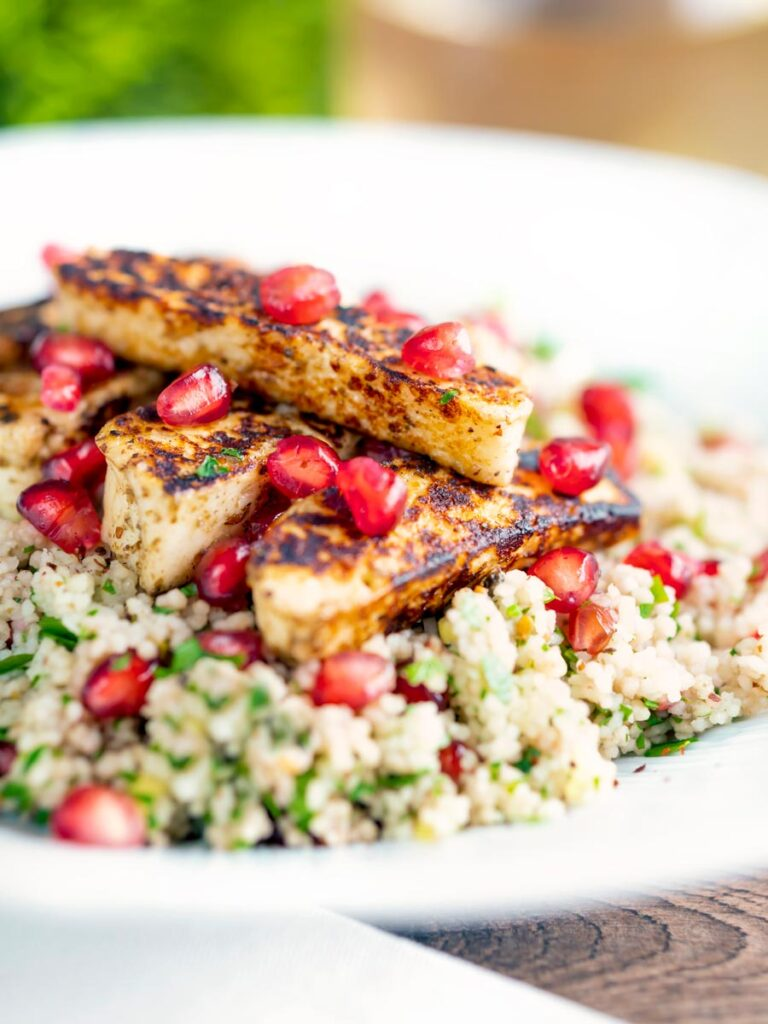 Seared halloumi cheese salad with pomegranate and couscous.