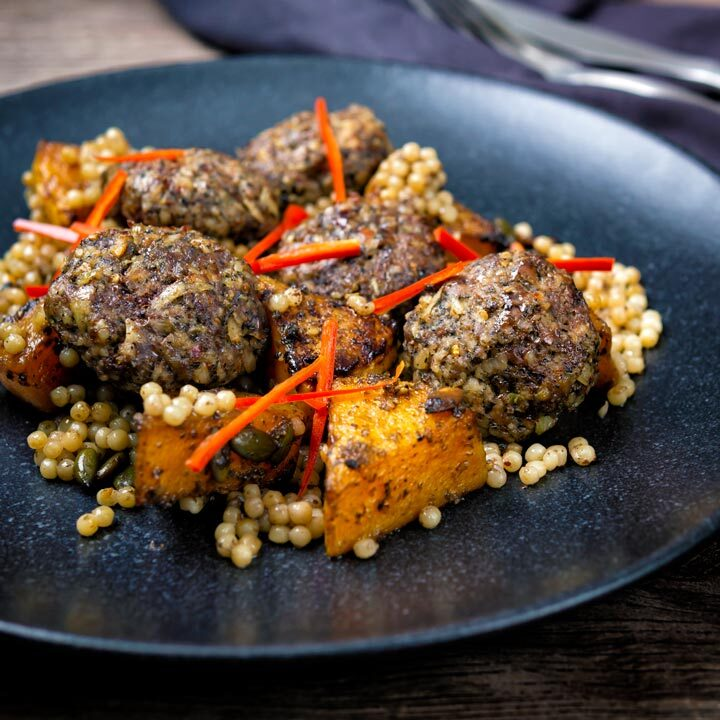 Mini lamb koftas served with roasted butternut squash, giant couscous and chilli strips.