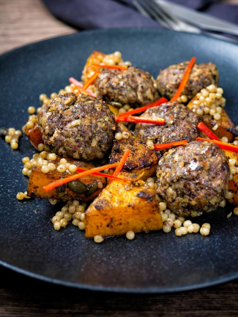 Mini lamb koftas served with roasted butternut squash and zaatar giant couscous.