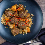 Overhead mini lamb koftas served with roasted butternut squash and zaatar giant couscous featuring a title overlay.