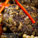Close up lamb koftas served with roasted butternut squash and zaatar giant couscous featuring a title overlay.