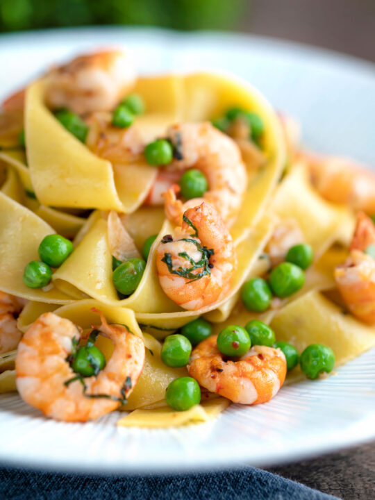 Prawn and pea pasta with pappardelle and shredded basil.