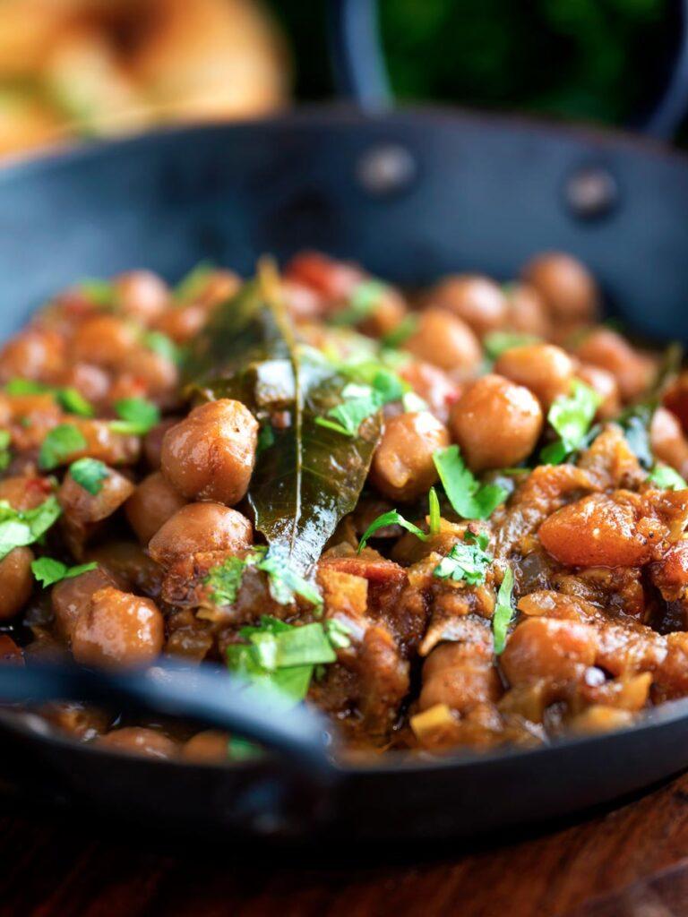 Vegan Punjabi chole masala curry or chana masala served in an iron karai.